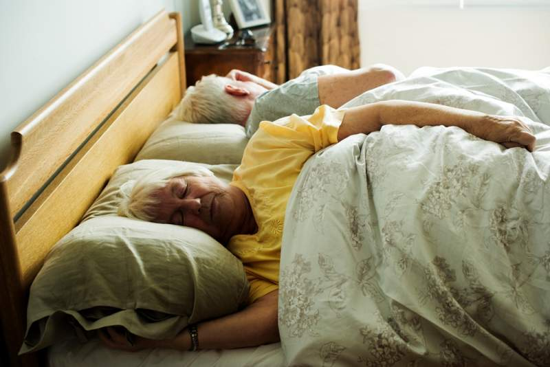 elderly-caucasian-couple-sleeping-on-the-bed