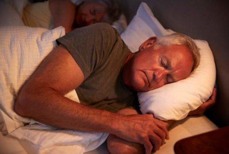 peaceful-senior-man-asleep-in-bed-at-night