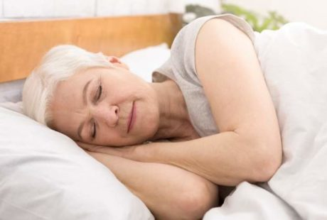 senior-woman-sleeping-in-bed-in-morning