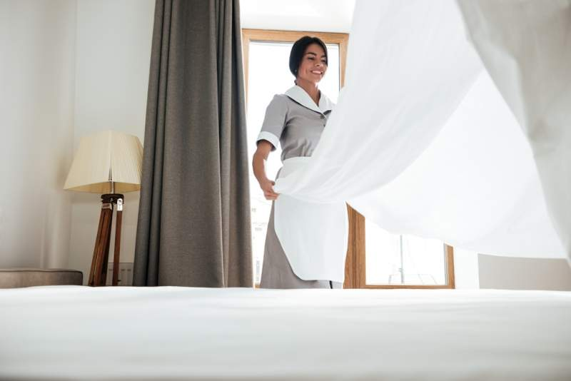 hotel-maid-changing-bed-sheet