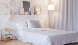 modern-bedroom-with-floor-lamp-and-decorations