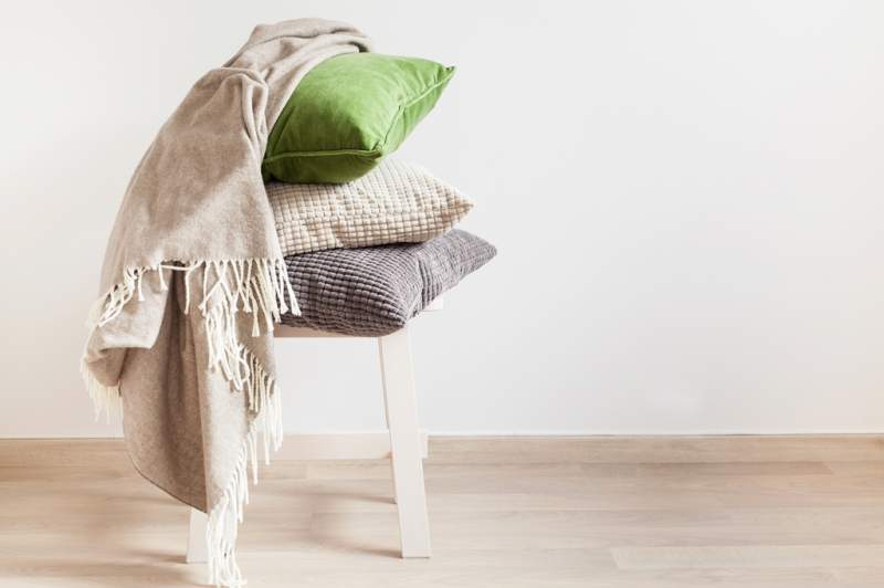 gray-and-green-cushions-throw-cozy-home