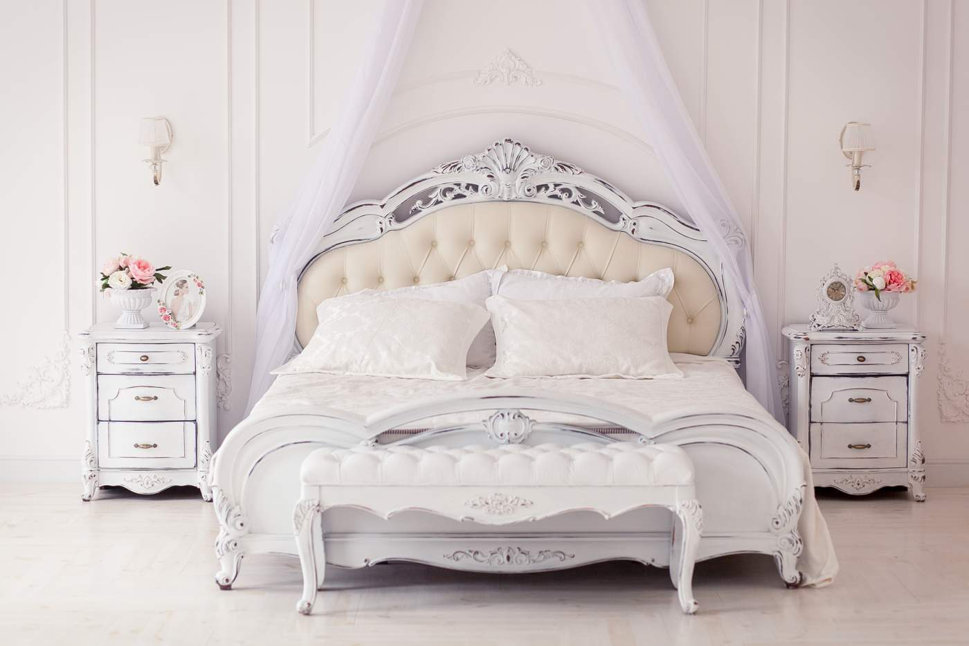 Bright, cozy stylish interior bedroom beautiful rich antique furniture four-poster bed